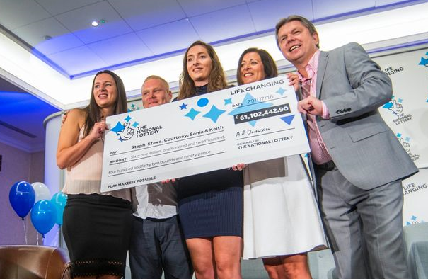 The Davies family receiving their EuroMillions jackpot win