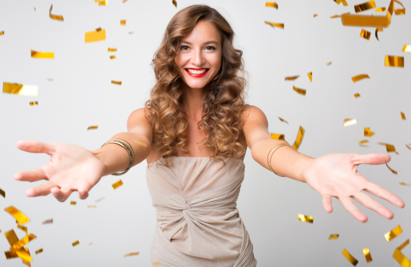 woman throwing confetti, lottery results, winning