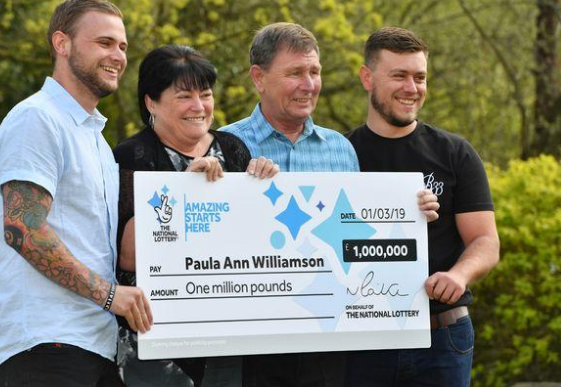 Paula Williamson celebrating her lottery win with her sons
