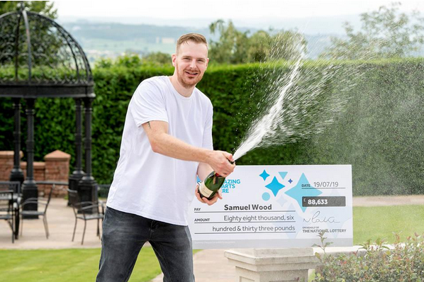 Samuel Wood celebrating his EuroMillions win