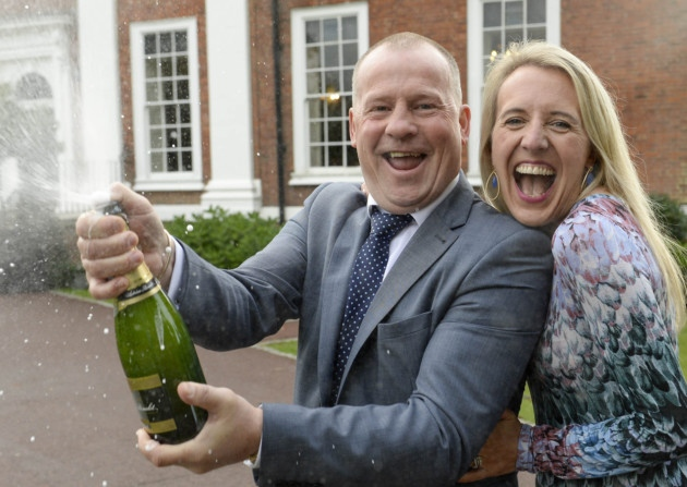 Liz and Frank Anderson celebrate winning the lottery with champagne