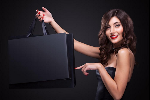 woman holding a shopping bag, shopping spree