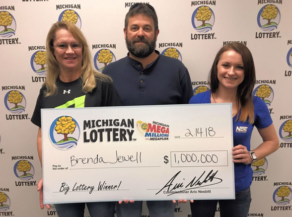 Brenda Jewell with her winning Mega Millions prize