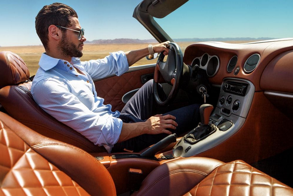 Man driving a sports car, how to maximise your Cancer traits to win the lottery