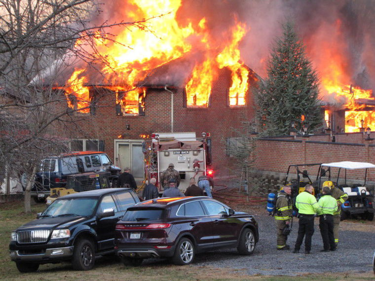 Powerball winner's house goes up in flames