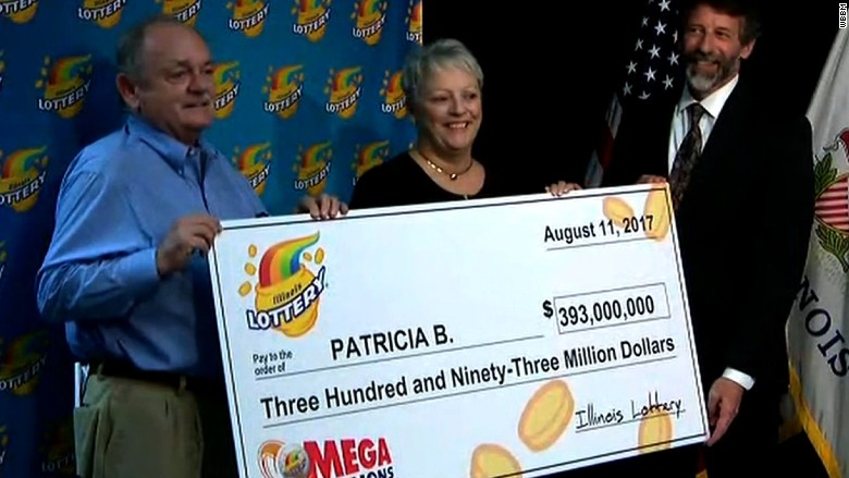 Patricia receiving her Mega Millions oversized cheque