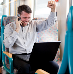 Winning man in train, happy man in train, lottery winner reaction