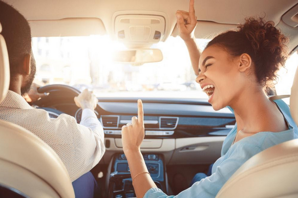singing in a car, songs to inspire you, songs to give you the winning feeling